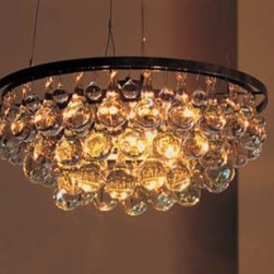 Ochre Arctic Pear Chandelier - This stunning ring chandelier comes in several sizes and is one of the most asked-about fixtures we have on Houzz. It adds elegant bling to any room in the house, with its unique glass drops reflecting the glow provided by the light bulbs inside.