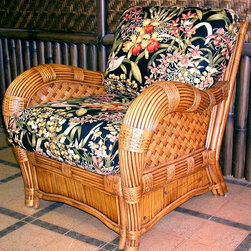 Spice Island Wicker - Armchair with Wicker Frame (Wheat) - Fabric: WheatThis spacious armchair features plenty of room for comfort and is imposing in its swooping rolled arms and gentle curvature.  Skirt features traditional sheeting while sides and back insets are weaved rattan.  Cinnamon finish seems to glow and will warm your decor.  Looking to add a bit of warmth, character, and texture to your outdoors?  Choose the fabric for the cushion to ensure that this chair is just your style. * Solid Wicker Construction. Cinnamon Finish. For indoor, or covered patio use only. Includes cushions. Pictured with Wild Orchard Black Cushions. 33.5 in. W x 36 in. D x 36 in. H