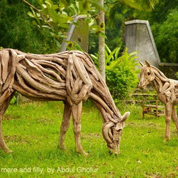 Driftwood sculptures - Life size driftwood horse sculptures of a grazing mare and a filly adding aesthetic nuance in your gardens.