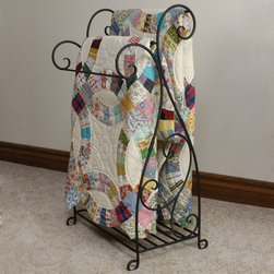 J & J Wire - J & J Wire Scrolled Wrought Iron Quilt Rack Multicolor - 4036 - Shop for Caddies and Stands from Hayneedle.com! With its rustic charm and quality construction the J & J Wire Scrolled Wrought Iron Quilt Rack is a fitting display stand for three of your heirloom quilts. The ornate scrollwork provides a bit of decoration but won't detract from your show-stopping quilt patterns. The bottom shelf can be used to display your favorite collectibles or simply to prevent your valuable quilts from touching the floor. Made in the USA by skilled craftsman this quilt rack is fabricated from durable welded wrought iron with the highest quality black powder-coat finish. It arrives in two pieces which slide together easily for instant assembly. About J & J Wire Inc.Located at the Industrial Park in Beatrice Nebraska J & J Wire Inc. started 25 years ago as a wire-forming business manufacturing mostly houseware items. Since then the company has grown into a metal fabrication business serving customers in many different manufacturing sectors in the United States and Canada. From quilt racks to wine racks J & J Wire is committed to creating handmade works of art at affordable prices.