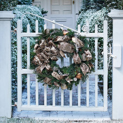 Frontgate - Designer Outdoor Christmas Wreaths - Frontgate Christmas Decor - Café au Lait has clear LED and prism lights; Burgundy/Gold has clear LED and prism lights; Red/Green has red and green LED lights. Outdoor ornaments, designer ribbon and acrylic picks beautifully withstand the elements. Cordless design allows for boundless decorating options. Operate on three D batteries (not included). Each piece arrives expertly assembled; may require some shaping after unpacking. The look of custom-dressed greenery is yours in an instant with our Designer Pre-Decorated Outdoor Wreaths. The exclusive cordless designs feature a blend of lush, realistic greenery, richly embellished with strands of faceted crystals, oversized outdoor ornaments and yards of embroidered and jeweled ribbon - all expertly placed. Pre-lit with 120 lights, they make an elegant, stunning presentation day or night. Cafe au Lait has clear LED and prism lights; Burgundy/Gold has clear LED and prism lights; Red/Green has red and green LED lights .  .  .  .  .