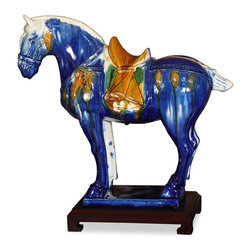 China Furniture and Arts - Tang Dynasty Horse - One of the greatest artistic achievements in the Tang Dynasty (618-906) was the invention of Tri-Color pottery. The technique has passed down to our present day as it is shown in this magnificent horse. Made by artisans from LuoYang, the ancient capital of nine dynasties throughout Chinese history. Color may vary slightly with each one due to the hand made nature of the material, please allow us to select for you.