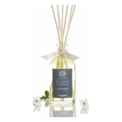 "Antica Farmacista - Santorini Scented Diffuser - Petite Size for a Petite Space"" Our Antica's new collection of 100ml Home Ambiance Fragrances are approved for carry-on baggage, making this reed diffuser a great gift for an out of town guest or a fragrant reminder of home to bring along wherever life takes you. The perfect size for your personal space and the perfect price for your wallet. Santorini - is a medley of crisp citrus and green notes artfully paired with exotic spice and natural wood essences. Top notes of vibrant italian bergamot sweet verbena and fresh vetyver are enhanced by the subtle sweetness of rosewood, warm sandalwood and aromatic cardamom. * 100 ml * Complete with birch reeds and gift tag * Made In Italy"