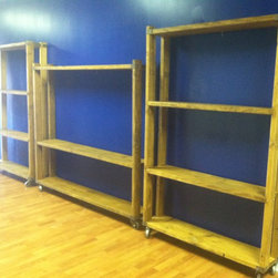 Shelving - Rustic rolling shelves to display dance studio trophies.