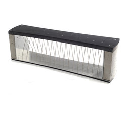 Axis - The Axis bench is made from Aluminum, Concrete, Stainless Steel Cable and Mahogany dyed Black. It has an undulating pattern of cable which plays off of its convex sides. Unorthodox concrete anchors the ends both visually and structurally.