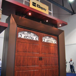 International Builders Show 2014 - Clopay Gallery Collection insulated steel carriage house style garage door with Ultra-Grain paint finish and decorative wrought iron windows. Dual direction grain. Low-maintenance - won't rot, warp or crack. Affordable alternative to wooden garage doors.