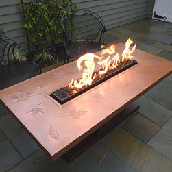 "Autumn Flame - Copper topped fire table with ""Leaf"" imprint."