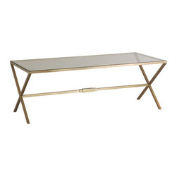 Kathy Kuo Home - Valletta Hollywood Regency Antique Brass Cross Base Coffee Table - This classic, elegant design complements styles from Hollywood Regency to modern. Antique brass legs form X patterns on each side of the clear glass rectangular top. The transparent rectangular top and open base make it a coffee table that enhances any area in which it's placed.