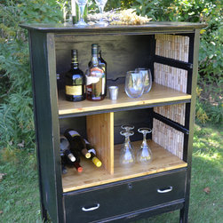 Upcycled Class Shabby Chic Wine/Liquor Cabinet - Classy meets Shabby Chic with this unique upcycled early 20th century antique oak dresser turned bar storage. Add this one of a kind piece to your living space with a black semi-gloss finish that gives this piece a classy stylized look, while the slightly distressed finish adds a bit of Shabby Chic country flair. The bar top and shelves have three layers of polyurethane to protect the finish. There's plenty of space to store your libations and drink glasses, along with a wine cubby that can store to 10-12 bottles. The bottom drawer is a great place to store your cocktail napkins and drink mix supplies. Wheels make the bar easy to move to wherever you're entertaining.