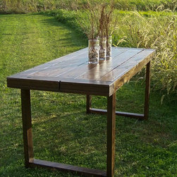 Contemporary Barn Table - This six to eight person table has the perfect balance of modern design meeting country life, paying attention to details from the old country. It incorporates hand-forged square head nails, solid barn beam end caps and an aged wood top. Photo: Jen W. Photography (www.facebook.com/JenWPhotography)