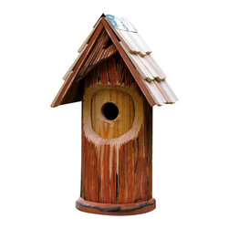 Heartwood - The Woodcutter Bird House - Add  a  touch  of  magical  forest  to  your  lawn  with  The  Woodcutter,  an  enchanting  combination  of  rustic  simplicity  and  beautifully  imaginative  design  details,  like  the  dramatic  asymmetrical  winged  front  gable.  Like  its  fairy  tale  namesake,  Heartwood's  Woodcutter  is  strong,  sturdy  and  a  reliable  protector  of  precious  characters--like,  for  example,  yourown  beloved  birds.  Storybook  perfection  plus  rugged  construction  for  real-world  use  make  this  round  house  an  all-around  favorite.  Mounting  plate  included.                  8x9x16              1-1/2  hole              Handcrafted  in  USA  from  renewable,  FSC  certified  wood