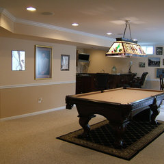 mediterranean basement by J & J Builders General Contractors, LLC