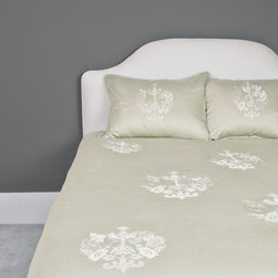 Luxe Embroidered Duvet Cover, The Lafayette Green - This 350-thread count bedding is defined by its ornate and regally embroidered emblem scattered across a beautiful pale olive backdrop.