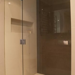"""Frameless Shower Enclosures - Custom frameless shower door with over sized door for accessibility.  Glass is 1/2"""" optiwhite low iron."""