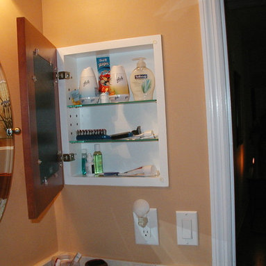 Recessed Picture Frame Medicine Cabinets with No Mirrors - Large Cinnamon Concealed Cabinet with white interior from ConcealedCabinet.com.  You insert your own artwork and change it as often as you like!
