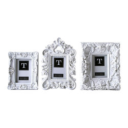 White Mod Frames - Set of 3 - 7 x 8.5, 9 x 1.5, 8 x 12 - Wonderfully ornate but restrained in chalk white, the Set of Three White Mod Frames work well in a row or cluster, but scattered through a dark bookshelf or jewel-toned room, they draw the look together with exquisitely baroque highlights. Pay homage to the aristocratic styles of the past while keeping a grounded sensibility with these white resin photo frames.