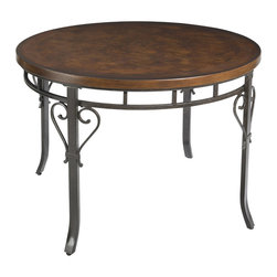 Powell - Powell Abbey Road Round Dining Table in Bronze - The abbey road round dining table is a stylish centerpiece for your dining room. The table features a spacious, round birch veneer MDF top accented with a metal base. Each leg features a double swirl design. Great for a range of decor styles from traditional to contemporary!