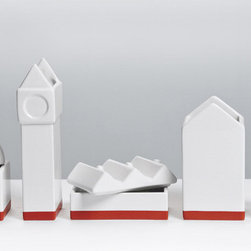 Modern White and Red Porcelain Desktop Organizer - The Town: Office Desktop Organizer turns a workspace necessity into a desktop sculpture. This white porcelain design includes several modular pieces—to be used as pencil cups, paper clip holders, and more—shaped like a small metropolis. With a landmark clock tower and a band of red at the bottom resembling a brick street, this accent will make you the Mayor of Desktown (population: 1).