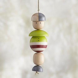 Dad Ornament - Our friendly family members are crafted in simple shapes of pinewood, strung together on a cord and finished with colorful painted details. Coordinating mom, dad and child ornaments let you gather an entire family to decorate your holiday tree. Studiopatró founding artist Christina Weber strives for memorable simplicity in everything she creates. Her sources of inspiration—architecture, nature and pattern—can be seen in her ornament designs, crafted of pale wood with bright strokes of color.