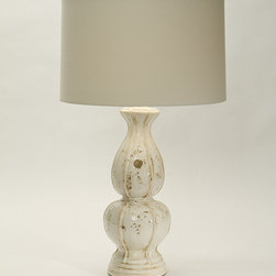 Briana Bianco Lamp - A pottery base of rich cream delicately flecked with earthen tones reminds one of the stoneworks that grace Italian piazzas. Carved circlets accentuate the base of the Briana Bianco Lamp, distinguished by its fusion of round and oval shapes.  The shade in Sailcloth White allows for soft illumination ideal in a space that calls for warm and welcoming light.