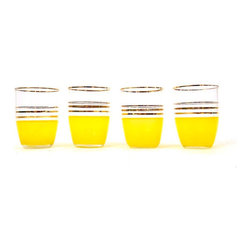 Yellow Vintage Cups by The Orange Collective - I love how quaint these gold-striped juice glasses are, but they've got a pop that makes me smile. They'd be the perfect addition to a little breakfast at home.