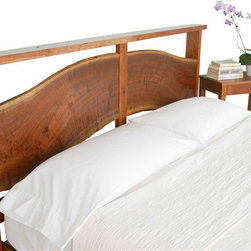 Stephanie Bed - The headboard of this gorgeous bed features a single, naturally curved board from an American Black Walnut tree. Platform frame is American Black Cherry with Black Walnut skirt.