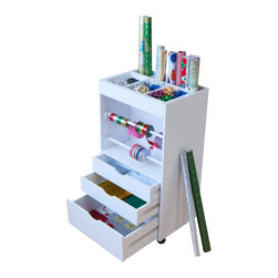 Studio Designs - Wrapping Cart - Four 19 in. Poles for Ribbons. (4) Casters for Mobility with 2 Locking for Stability. 19 in. W x 9 in. D Top Storage for Bows and Supplies. 17.5 in. D Storage Space for Wrapping Paper Tubes. (2) Small Storage Drawers: 17.5 in. W x 12.5 in. D 3.25 in. H. (1) Large Storage Drawer: 17.5 in. W x 12.5 in. D x 5.25 in. H. Comes Fully Assembled except for Casters. 20 in. W x 14 in. D x 35.5 in. H
