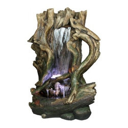 YOSEMITE HOME DECOR - Tree Stump Waterfall - This intricate tree stump waterfall features a somewhat glossy finish over a natural array of browns and greens throughout.  The water peacefully cascades down the center of the fountain and pools at the bottom, slowly dripping down a few scattered waterfalls at the base.  Indoor and outdoor rated.
