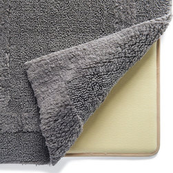 "Frontgate - Memory Foam Mat - 23"" sq. - Tucks neatly under our Resort Bath Rugs. Can be used with our Nonskid and Reversible Resort Rugs. Moisture-resistant barrier prevents cracking and peeling. Cleans with mild soap and water. Our Memory Foam Mat adds cushioned support to any bath or accent rug. The densely packed memory foam layer is completely encased in a nonskid latex sleeve to prevent the mat from sliding on the floor and the rug from slipping on the mat.  .  .  .  ."