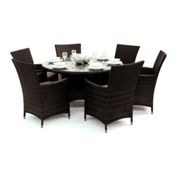"Reef Rattan - Reef Rattan Tobago 7 Pc Round Dining Set - Chocolate Rattan / Taupe Cushions - Reef Rattan Tobago 7 Pc Round Dining Set - Chocolate Rattan / Taupe Cushions. This patio set is made from all-weather resin wicker and produced to fulfill your needs for high quality. The resin wicker in this patio set won't fade, shrink, lose its strength, or snap. UV resistant and water resistant, this patio set is durable and easy to maintain. A rust-free powder-coated aluminum frame provides strength to withstand years of use. Sunbrella fabrics on patio furniture lends you the sophistication of a five star hotel, right in your outdoor living space, featuring industry leading Sunbrella fabrics. Designed to reflect that ultra-chic look, and with superior resistance to the elements in a variety of climates, the series stands for comfort, class, and constancy. Recreating the poolside high end feel of an upmarket hotel for outdoor living in a residence or commercial space is easy with this patio furniture. After all, you want a set of patio furniture that's going to look great, and do so for the long-term. The canvas-like fabrics which are designed by Sunbrella utilize the latest synthetic fiber technology are engineered to resist stains and UV fading. This is patio furniture that is made to endure, along with the classic look they represent. When you're creating a comfortable and stylish outdoor room, you're looking for the best quality at a price that makes sense. Resin wicker looks like natural wicker but is made of synthetic polyethylene fiber. Resin wicker is durable & easy to maintain and resistant against the elements. UV Resistant Wicker. Welded aluminum frame is nearly in-destructible and rust free. Stain resistant sunbrella cushions are double-stitched for strength and are fully machine washable. Removable covers made with commercial grade zippers. Tables include tempered glass top. 5 year warranty on this product. PLEASE NOTE: Throw pillows are NOT included. Round Table: W 53"" D 53"" H 30"", Chairs (6): W 24"" D 24"" H 33"""