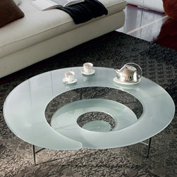 Cattelan Italia - Spiral Coffee Table   Cattelan Italia - Made in Italy by Cattelan Italia. Bring art-gallery atmosphere to any contemporary living or entertaining space with the Spiral Coffee Table, an original product of inventive Italian artistry. This fully-functional 3D masterpiece features a glass tabletop crafted into a whimsical, curvy silhouette, a definite conversation starter and attention magnet. The svelte steel base, which comes in several lacquer options, is equally stylish and adds to the avant-garde design. Perfect for home, office, or restaurant use. Choose from a variety of glass styles.