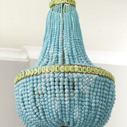 Horchow - Turquoise Drape Chandelier - The turquoise color makes this chandelier striking and beautiful. I even like the green accents at the top and around the center.
