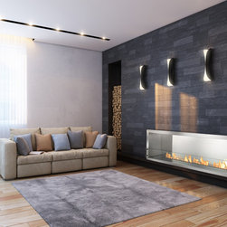 "Ignis Ethanol Fireplace Inserts / Fireboxes FB4800-S - Single-sided, the FB4800-S is an ethanol firebox idyllic for use in a commercial or large residential setting. In demand by those in the hospitality industry, this ethanol fireplace insert boasts a linear flame stretching over 43"" in length befitting the most upscale spaces. A warm invitation into a business or home, this fire box uses the popular Ignis EB4800 Ethanol Burner. Composed of grade 304 polished stainless steel, which is known for its durability and high-heat competency, this ethanol fireplace insert box offers double wall construction, using stainless steel of 3mm width. Supplementing its level of protection, the fireplace insert is insulated with a patented rock wool insulation, resulting in heat resistance and a higher level of safety than competing brands. When creating this supreme-quality zero clearance ethanol fire box, the end-users' ease of operation and the installers' ease of build-in were considered first. For easy installation, simply use surrounding flange to build the firebox into the wall, existing fireplace enclosure or custom case good. Because this fireplace is powered by clean burning bio ethanol fuel, there is no need to install a chimney, flue nor an expensive and bulky venting system. The FB4800-S Ethanol Fire Box offers the perfect stage on which the long bed of flames can play, dance and entertain. The stainless steel construction makes the assist, reflecting the wonder of the fire on its surface. The result is a stunning display that will evoke emotion, thought and conversation no matter its locale. This firebox is assembled manually and made using patented technology that is proprietary to the Ignis Development."