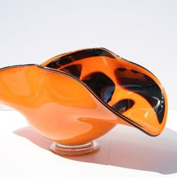 None - Hand-blown Glass Decorative Ladybug Dish - Add color and style to your residential environment with this distinctive,decorative dish. Splashes of orange and black draw instant attention to the hand-blown glass,which can be placed on any flat surface or mounted easily on the wall.