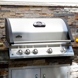 """Napoleon Mirage BIM605RBI Built-in Grill with Infrared Searing Burner - The product specialists at Hayneedle have been extensively trained by the manufacturer of Napoleon grills. These specialists know the product inside and out top to bottom front to back. They're here to help you with every step of your Napoleon grill purchasing process. Learn everything you need to know as you customize your grill island with drawers doors pizza ovens and more! Call 866-579-5183 to speak with a product specialist and start building your dream grill island today. Hours: Monday-Friday 9 a.m.-7 p.m. E.T. Drop an 845-square-inch beast into the middle of your outdoor kitchen and watch the heat rise. The BIM605RBI Built-in Grill with Infrared Rear Burner is perfect for preparing large meals for big backyard gatherings. This 304 stainless steel grill is loaded with pro-grade features and unique specifications. You'll get dual cooking surfaces totaling 79 500 BTUs of heat with 3 traditional stainless steel bottom burners on the left side and a high-intensity ceramic infrared bottom burner on the right. For final searing perfection there's also a rear-mounted infrared rotisserie burner. Available in natural gas and propane fueled models. Additional Information LIFT EASE stainless steel roll top lid with cast aluminum """"""""no-rust sides"""""""" that allow zero-clearance installation from the rear i-GLOW ergonomic knobs with backlight technology Tube burners positioned front to back for exact heat control and independent grilling zone use. Choose direct cooking to broil your food or indirect cooking for an oven-like experience. Stainless steel WAVE reversible-channel cooking grids hold drippings to keep food juicy Patented stainless steel sear plates easily control flare-ups and protect the 304 stainless steel burners Right-side ceramic infrared burner quickly locks in flavor Infrared rear rotisserie burner for sealing in juices Full LIFETIME warranty included About Napoleon GrillsRising up from its"""