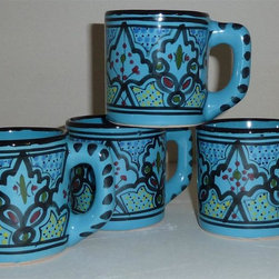 Le Souk Ceramique - Sabrine Coffee Mug - Set of 4 - Set of 4. 12 Fluid Ounces. Hand Painted . Hand Made . Dishwasher safe . Microwave safe . Made in Tunisia. Lead free glazes . Meets CA Prop 65 . Meets all Federal StandardsIt seems we've captured the color straight from the sea! Soothing in cool, watery turquoise, our Sabrine pattern represents everything we love about art in pottery. A contemporary take on tradition, Sabrine displays intricate details of the fusion of the Spanish-Moorish art form. With artistic elements of the intersecting arches embellished with spots of color, our Sabrine pattern inspires thoughts of ancient at and architecture in a lavish dinnerware collection.