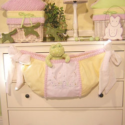 Brandee Danielle Froggy Toy Bag - Utilize hanging space on the sides of cribs, bookshelves or walls with this Brandee Danielle Froggy toy bag. Even though it's meant for toys, this versatile product can be used for socks, knickknacks or anything else you want to keep up and out of the way. It's super cute too!