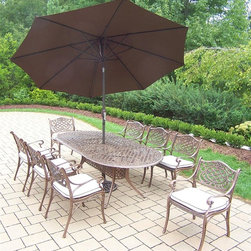Oakland Living - 11-Pc Patio Oval Dining Set - Includes one dining table, 9 in. tilt crank umbrella with stand, eight cushioned chairs and metal hardware. Fade, chip and crack resistant. Traditional lattice pattern and scroll work. Handcasted. Umbrella hole table top. Hardened powder coat. Warranty: One year limited. Made from rust free cast aluminum. Antique bronze finish. Minimal assembly required. Chair: 21.5 in. W x 23 in. D x 34 in. H (27 lbs.). Table: 84 in. L x 42 in. W x 29 in. H (99 lbs.). Overall weight: 359 lbs.This dining set is the prefect piece for any outdoor dinner setting. Just the right size for any backyard or patio. We recommend that the products be covered to protect them when not in use. To preserve the beauty and finish of the metal products, we recommend applying an epoxy clear coat once a year. However, because of the nature of iron it will eventually rust when exposed to the elements. The Oakland Mississippi Collection combines southern style and modern designs giving you a rich addition to any outdoor setting.