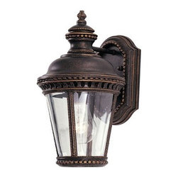 Murray Feiss Castle Outdoor Wall Lantern - 11.75H in. Grecian Bronze - The Grecian bronze finish of the Murray Feiss Castle Outdoor Wall Lantern is great for your Victorian style home. This light features clear bent beveled-glass shades. For ample outdoor lighting use one 100-watt E bulb. Clean the fixture with a damp cloth and mild soapy water and the shades with household glass cleaner. This light measures 11.75H x 7W x 8.25D inches.About Murray Feiss LightingThree generations have built Murray Feiss as a renowned name in lighting and it now stands as a leader with a reputation for impeccable craftsmanship innovative design and honest value. Murray Feiss prides itself as the foremost designer and manufacturer of interior and exterior lighting and home decor in the lighting industry. Over 3 800 skilled artists and technicians bring Murray Feiss designs to life meticulously finishing and quality-testing each exclusive product. Murray Feiss Lighting has expanded its extensive copyrighted line of products to include grand chandeliers casual fixtures vanity bath lights with coordinated bath hardware outdoor lighting lamps torchieres wall brackets mirrors and decorative accessories. Whether outdoor or in lighting from Murray Feiss means high quality and innovation.