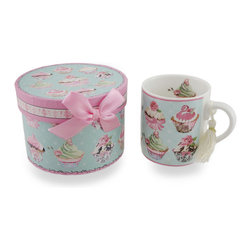 Zeckos - Ceramic Victorian Cupcake Tea/Coffee Mug with Decorative Storage/Gift Box - Have your cupcakes, and them with tea This Victorian themed coffee/tea mug gift set features an all-over design of tempting cupcakes and pretty pink roses Made from ceramic, the mug features a white tassel dangling from the handle, and includes a complementing decorative pink and green paperboard gift/storage box with sparkling glitter accents and finished off with a pink bow Store it in the box when not in use, or use the box as a display piece in your curio cabinet The mug measures 4 1/4 inches (11 cm) tall, 3 7/8 inches (10 cm) diameter while the decorative box is 3 3/8 inches (9 cm) high and 4 5/8 inches (12 cm) in diameter. It makes an sweet treat of a gift for both the young, and the young at heart sure to be loved.