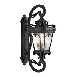 Kichler Lighting - Kichler Lighting 9360BKT Tournai Traditional Outdoor Wall Sconce - With its heavy textures, dark tones, and fine attention to detail, this 4 light outdoor wall fixture from the Tournai collection stands out from other outdoor fixtures. Handmade from cast aluminum, its distinctive Textured Black finish and Clear Seedy Glass panels give this piece a unique aged look.