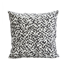 Checker Pillow, Black + White - Classic, geometric patterns get an unexpected makeover. The checker pattern is re-imagined, evoking the gentle flow of shallow water, as dappled sunlight and reflections play upon the surface. Subdued color palettes with an organic twist modernize this traditional design for a fresh interior space.