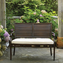 Frontgate - Palm Outdoor Bench with Cushion, Patio Furniture - Durable wrought aluminum frame. Classic coastal style mimics the look of wood plantation shutters. Available in Oyster or Mahogany finish. Crafted in durable wrought aluminum, The Palm Bench by Summer Classics combines gentle sloping curves with a shutter back design. This unique styling offers a transitional look that will make a subtle statement in any outdoor setting. . . . Note: Due to the custom-made nature of the cushions, any fabric changes or cancellations made to the Palm Collection by Summer Classics must be made within 24 hours of ordering.