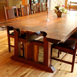 Live Edge Dining Room Tables - NEWwoodworks - Three large walnut planks, complete with live edge from the original root system of the tree, top a custom walnut base crafted with more live-edge components.