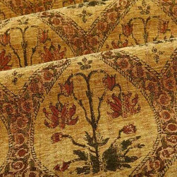 Fabrege Floral Upholstery Fabric in Gold - Fabrege Floral Upholstery Fabric in Gold has a chenille like relief-texture and a slightly rustic feel. Perfect for upholstering antique items. Made in Belgium from a blend of 64% Rayon and 36% Polyester. Cleaning code: S. Repeat: 17″V 9″H; Width: 54″.