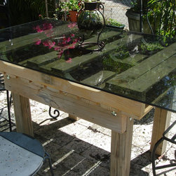 Furniture made from Recycle Wood/ Iron and Intriguing objects. Hand painted pill - Made from a pallet. 4x4 legs, glass top.