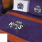 Sports Coverage - NBA Sacramento Kings Bedding - MVP Micro Suede Comforter - Full - The NBA Sacramento Kings MVP Micro Suede Collection is unique in its appeal to both young and more mature tastes. Sporting team colors with a soft leather looking stripe. The best part of this new look is its ultra soft and washable faux suede fabric which is perfect for bedding because it stays soft. Color fast and wrinkle-free. It is a great way to show support for your favorite NBA team, and it makes the perfect gift for the ultimate fan.   Show your Basketball team spirit with this great looking officially licensed MVP Micro Suede comforter. This comforter is made from ultra soft and washable faux suede fabric reverse to a gray and white cotton blend with generic team print to give your athlete full coverage. Featuring Sacramento Kings team colors, each comforter has the team logo screen printed in the center. The Comforter is reversible to a Solid Jersey. Soft but durable. Wash in cold water and tumble dry in low heat. 100% Polyester Microsuede top and 100% Polyester Jersey  bottom, filled with 100% Polyester Batting.