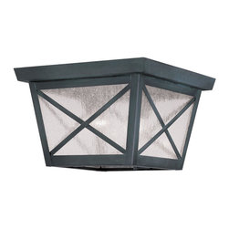 """Livex Lighting - Montgomery Outdoor Flush Mount Ceiling Fixture With 2 Lights - Featuring a prominent workman style design, the Montgomery two light outdoor ceiling fixture features a simple rustic kerosene lamp design with clear seedy glass with """"x"""" shaped guards."""