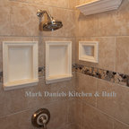 Mark Daniels Bathroom Ceramics - Recessed Bathroom Tile Niches - Notice how I kept the tops of the niches and the soap picture frame in line. Then I ran the accent underneath the recessed soap symmetrically.  The idea here was to show off my new products including my architectural niches and crown molding shelves. Shown in matte almond colored glaze.