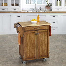 HomeStyles - 32.5 in. Kitchen Cart in Cottage Oak Finish - Prepare your food in style with this mobile kitchen cart! It features a natural wood top with an easy to clean surface, a cabinet with adjus